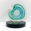 "<p></p> <h1 style=""margin:0px;""><font size=""4""><b>Hamilton Health Sciences Achievement Award</b></font></h1> Swirling bands of colour encircle the center of this heart shaped glass disc mounted atop an engraved granite base.  <i><a href=""/Custom/Awards-and-Commissions/"" target=""_blank"" title=""Awards and Commissions - Kelly Lowe Glass."">Click here to go to the awards and commissions information page (link opens in a new window</a></i>  <i><a href=""/Glass/Awards/"" title=""Awards Sample Gallery"">If you are not on my main gallery of sample custom awards, click here to return there now</a></i>"