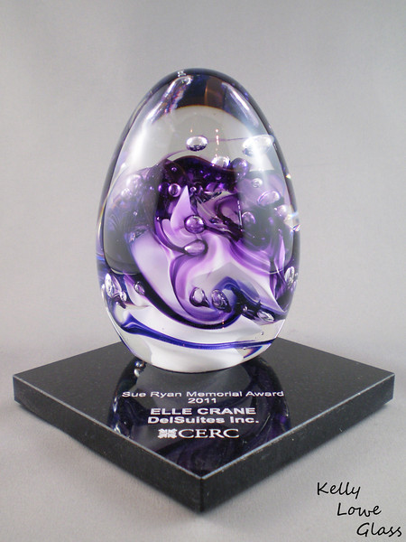 "<p></p> <h1 style=""margin:0px;""><font size=""4""><b>Canadian Employee Relocation Council - Sue Ryan Memorial Award</b></font></h1> Hand sculpted to accentuate the swirling of colour and to capture air bubbles, this glass teardrop sits atop an engraved granite vase.  <i><a href=""/Custom/Awards-and-Commissions/"" target=""_blank"" title=""Awards and Commissions - Kelly Lowe Glass."">Click here to go to the awards and commissions information page (link opens in a new window</a></i>  <i><a href=""/Glass/Awards/"" title=""Awards Sample Gallery"">If you are not on my main gallery of sample custom awards, click here to return there now</a></i>"
