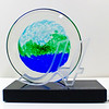 "<p></p> <h1 style=""margin:0px;""><font size=""4""><b>Hamilton Gallery of Distinction </b></font></h1> Water, earth and sky sit centered on a glass disc mounted atop a granite base. The letter fronting the award is made from waterjet cut and sandblasted glass.  <i><a href=""/Custom/Awards-and-Commissions/"" target=""_blank"" title=""Awards and Commissions - Kelly Lowe Glass."">Click here to go to the awards and commissions information page (link opens in a new window</a></i>  <i><a href=""/Glass/Awards/"" title=""Awards Sample Gallery"">If you are not on my main gallery of sample custom awards, click here to return there now</a></i>"