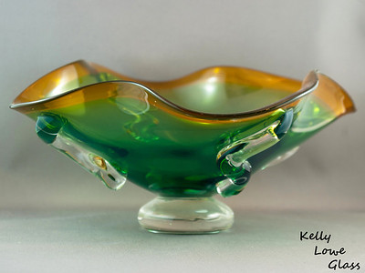 """""""Gabby"""" Bowl:  Thick glass shaped by hand and the downward pull of the Earth's gravity, finished by applying drops of molten glass to the sides as an extra, dramatic touch to these solid pieces.  Currently at Gallery 329 (link opens in a new window)  in Ridgeway, Ontario."""