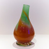 Glass Valve Shaped Vase:<br /> <br /> Another take on the form of the vase, with a large bowl shaped base rising to a smaller opening. Better suited to contain only a few flowers for a dramatic effect.