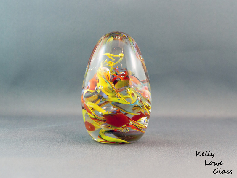 "Glass Raindrops:  Raindrops of colour, which will always remain falling where you want it most.  <i>Large:</i>  Widest Point: 6.5cm Height: 12cm Weight: Approx 685g.  <i>Medium</i>  Widest Point: Approx 5cm Height: Approx 10cm Weight: Approx 420g.  <i><a href=""/AvailablePieces/Teardrop-Paperweights/"">Click here to see examples of available colours</a></i>"