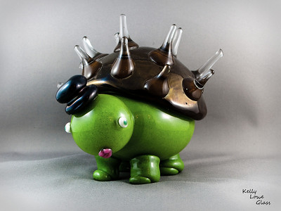 Porkutort:  Ol' Porkutort herself: half porcupine, half tortoise. The second of the Kritters to spawn from the depths of the glass ovens, she's also the most timid. Why? Stubby legs. Not that anything eats porkutorts mind you, she's just self conscious.   Click here to see our current batch of available Kritters