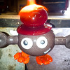 "Dustacean's Baby Photos:  Plucked from the primordial Kritter goo and blown, sculpted and worked into something a little less... well, molten, this Dustacean is obviously happy to finally have feet. He's hot, and knows it, - in fact in this picture he's still at least a few hundred degrees celsius, hence the colouration... as he cools his body will take on a bright red hue while his hat will slowly darken to a solid black. His smile, however, will never waver.   <i><a href=""/AvailablePieces/Kritters/"">Click here to see our current batch of available Kritters</a></i>"