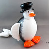 "Pengueluga:  Half penguin, half beluga whale, this young chap is made for the water. A first rate vegetarian spear fisherman, as well as the fanciest of solo synchronized swimmers, getting him out of the water is next to impossible - especially when it's time to take his bath!   <i><a href=""/AvailablePieces/Kritters/"">Click here to see our current batch of available Kritters</a></i>"