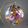 """<p></p> <h1 style=""""margin:0px;""""><font size=""""4""""><b>Traditional Hand Blown Christmas Ornaments</b></font></h1> Individually hand blown using the same methods glassblowers have used since antiquity, these ornaments are a holiday classic  just like great great great great great grandma may have had.   I make these Christmas balls in a variety of colours, (see the link below for more examples) including the multicoloured one pictured here. Each ornament begins life as liquid glass in a special glassblowing furnace, from which it's pulled and blown by mouth into a hollow sphere. During this process colour is added, which melts and is allowed to flow and combine throughout ornament, making each ball truly one of a kind: the color will never mix in the same way twice. While the piece is still hot a small glass loop is added to the top to make for easy hanging from a Christmas Tree or any other place one could wish to hang it, and finally it is slowly cooled over the course of 24 hours in a special glass kiln to ensure the glass is very strong and will last a lifetime.  Diameter - Approx 9.5cm (3.75"""") Weight: Approx 78g (0.17 lbs)  *Note: As each ornament is blown by mouth and is fully handmade some variation in the size of individual ornaments is to be expected. The measurements above should thus only be taken as an average, with some balls being larger and others being smaller.  <i>This piece is available in my Stoney Creek <a href=""""/Site-Stuff/Contact/"""" target=""""_blank"""">studio gallery</a>, my <a href=""""http://store.kellyloweglass.com"""" target=""""_blank"""">online store</a> (<a href=""""http://store.kellyloweglass.com/ornaments/traditional-blown-glass-ornament/"""" target=""""_blank"""">direct item link</a>) and in many local galleries. If you're interested in larger/custom orders, please <a href=""""/Site-Stuff/Contact/"""" target=""""_blank"""">contact me</a> and I'm sure we can work something out.</i>  <i><a href=""""/AvailablePieces/Ornaments/"""" target=""""_blank"""">Click here to be taken to a gallery of all """