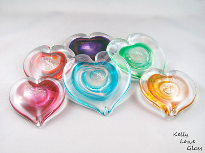 "Glass Hearts These hand sculpted glass hearts make for a unique Valentine's Day gift, a special decoration or gift for weddings, or simply a sign of your affection on any of the other day of the year. The hearts are solid glass and feature swirls of colour and adventurine gold within the interior of each piece. The gold catches the light and makes each heart sparkle with a life of its own, while the colour of the interior swirls can be chosen to ensure that the heart you give (or choose for yourself!) is a proper reflection of you and/or its intended recipient.  Customized engraving is available, and can be done at my studio using a diamond tipped engraving tool - the same tool I use to sign my work. This style of engraving is done in my handwriting, is offered free of charge, and as it takes only a moment is available on both custom pieces and those ready made and available for purchase from my studio gallery. Other styles of engraving can also be arranged: please feel free to inquire as to what options I have available.  Base point to top of glass: Approx 6-10cm (2.36"" - 3.94"") Widest point: Approx 6-10cm (2.36"" - 3.94"") Weight: approx 250g (0.55 lbs)  *Note - Due to these glass hearts being made in a variety of sizes (see above picture) the figures given are a range from the smallest to the largest, with all others falling in between.  This piece is available in my Stoney Creek studio gallery, my online store (direct item link) and in many local galleries. If you're interested in larger/custom orders, please contact me and I'm sure we can work something out."