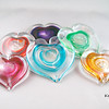 """<p></p> <h1 style=""""margin:0px;""""><font size=""""4""""><b>Glass Hearts</b></font></h1> These hand sculpted glass hearts make for a unique Valentine's Day gift, a special decoration or gift for weddings, or simply a sign of your affection on any of the other day of the year. The hearts are solid glass and feature swirls of colour and adventurine gold within the interior of each piece. The gold catches the light and makes each heart sparkle with a life of its own, while the colour of the interior swirls can be chosen to ensure that the heart you give (or choose for yourself!) is a proper reflection of you and/or its intended recipient.  Customized engraving is available, and can be done at my studio using a diamond tipped engraving tool - the same tool I use to sign my work. This style of engraving is done in my handwriting, is offered free of charge, and as it takes only a moment is available on both custom pieces and those ready made and available for purchase from my studio gallery. Other styles of engraving can also be arranged: please feel free to inquire as to what options I have available.  Base point to top of glass: Approx 6-10cm (2.36"""" - 3.94"""") Widest point: Approx 6-10cm (2.36"""" - 3.94"""") Weight: approx 250g (0.55 lbs)  *Note - Due to these glass hearts being made in a variety of sizes (see above picture) the figures given are a range from the smallest to the largest, with all others falling in between.  <i>This piece is available in my Stoney Creek <a href=""""/Site-Stuff/Contact/"""" target=""""_blank"""">studio gallery</a>, my <a href=""""http://store.kellyloweglass.com"""" target=""""_blank"""">online store</a> (<a href=""""http://store.kellyloweglass.com/romance/aventurine-glass-heart/"""" target=""""_blank"""">direct item link</a>) and in many local galleries. If you're interested in larger/custom orders, please <a href=""""/Site-Stuff/Contact/"""" target=""""_blank"""">contact me</a> and I'm sure we can work something out.</i>"""