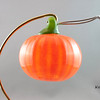 """<p></p> <h1 style=""""margin:0px;""""><font size=""""4""""><b>Blown Glass Pumpkin</b></font></h1> These blown glass pumpkins were originally made for a Halloween showcase as a small, inexpensive gift item. They proved popular and I enjoyed making them, and so I decided to make them a regular seasonal feature.  Height - Approx 7.5cm (3"""") Width - Approx 7cm (2.75"""") Weight: Approx 78g (0.17 lbs)  *Note: As each pumpkin is blown by mouth and is fully handmade some variation in the size of individual pieces is to be expected. The measurements above should thus only be taken as an average, with some being larger and others being smaller.  <i>This piece is available in my Stoney Creek <a href=""""/Site-Stuff/Contact/"""" target=""""_blank"""">studio gallery</a>, my <a href=""""http://store.kellyloweglass.com"""" target=""""_blank"""">online store</a> (<a href=""""http://store.kellyloweglass.com/holidays/halloween/pumpkin-ornament/"""" target=""""_blank"""">direct item link</a>) and in many local galleries. If you're interested in larger/custom orders, please <a href=""""/Site-Stuff/Contact/"""" target=""""_blank"""">contact me</a> and I'm sure we can work something out.</i>  <i><a href=""""/AvailablePieces/Ornaments/"""" target=""""_blank"""">Click here to be taken to a gallery of all my various ornament types (link opens in a new window)</a></i>"""