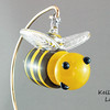 """<p></p> <h1 style=""""margin:0px;""""><font size=""""4""""><b>Hanging Glass Bee</b></font></h1> A seasonal favourite, or a feared adversary, the bee can be either depending on the individual. But where would we be without them? Less flowers, no honey and 54% less buzzing in the world... would you REALLY want that?  Some of these bees even come with crowns, showing off their royal status as queen bees.  Stinger to Nose: Approx 9cm (3.54"""") Across the Wings: Approx 6cm (2.36"""") Weight: Approx 150g (0.33 lbs)  *Note: As each piece is hand sculpted some variation in size is to be expected. The measurements above should be considered an average, with most pieces being slightly above or below these figures.  <i>This piece is available in my Stoney Creek <a href=""""/Site-Stuff/Contact/"""" target=""""_blank"""">studio gallery</a>, my <a href=""""http://store.kellyloweglass.com"""" target=""""_blank"""">online store</a> (<a href=""""http://store.kellyloweglass.com/ornaments/glass-bee-ornament/"""" target=""""_blank"""">direct item link</a>) and in many local galleries. If you're interested in larger/custom orders, please <a href=""""/Site-Stuff/Contact/"""" target=""""_blank"""">contact me</a> and I'm sure we can work something out.</i>  <i><a href=""""/AvailablePieces/Bugs-Bugs-Bugs/"""" target=""""_blank"""">Click here to see more of this bee and other glass insects (link opens in a new window)</a></i>  <i><a href=""""/AvailablePieces/Ornaments/"""" target=""""_blank"""">Click here to be taken to a gallery of all my various ornament types (Link opens in a new window)</a></i>"""