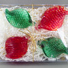 """<p></p> <h1 style=""""margin:0px;""""><font size=""""4""""><b>Package of Four Hand Sculpted Christmas Ornaments</b></font></h1> These glass ornaments are made to play with light in a way that will draw attention and add to any festive decor. Hang them from a Christmas Tree, on doors, from lights, from your nostrils, or go ahead and wear them as as kinda smallish and not very practical hat - I know you want to.  Each piece is fully handmade, and are currently available in gift boxes of four (as pictured here).  <i>This piece is available in my Stoney Creek <a href=""""/Site-Stuff/Contact/"""" target=""""_blank"""">studio gallery</a>, my <a href=""""http://store.kellyloweglass.com"""" target=""""_blank"""">online store</a> (<a href=""""http://store.kellyloweglass.com/gift-boxes/handmade-glass-ornaments-set-of-four/"""" target=""""_blank"""">direct item link</a>) and in many local galleries. If you're interested in larger/custom orders, please <a href=""""/Site-Stuff/Contact/"""" target=""""_blank"""">contact me</a> and I'm sure we can work something out.</i>  <i><a href=""""/AvailablePieces/Ornaments/"""" target=""""_blank"""">Click here to be taken to a gallery of all my various ornament types (link opens in a new window)</a></i>"""