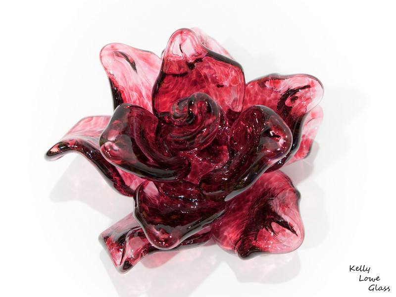 "Glass Flower:  A single flower, made to catch the light and diffuse it through its petals. Never wilting, never thirsting, this flower is a symbol of beauty: a brief moment captured, frozen, held for eternity.  <a href=""http://www.kellyloweglass.com/AvailablePieces/Sculpted-Glass-Flowers"">Click Here to See Other Examples of Sculpted Glass Flowers</a>"