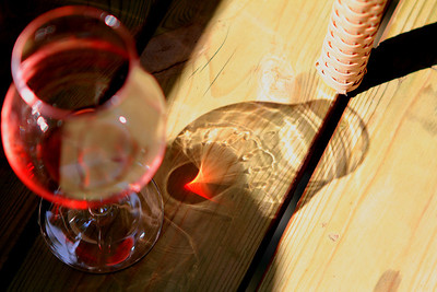 Reflections from a red wine glass