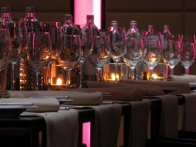 Wine Glasses under pink-purple lights