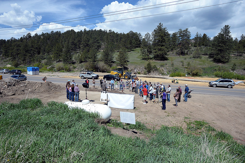 Glen Haven residents gather Thursday, June 1, 2017, for a groundbreaking ceremony for the new Glen Haven Town Hall and Community Building. The new town hall will replace the former building that was washed away by the 2013 flood. (Photo by Jenny Sparks/Loveland Reporter-Herald)