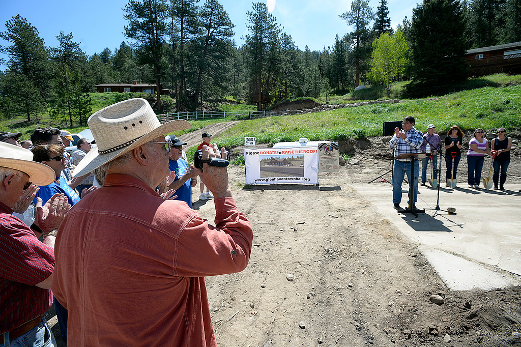 . Jim Engelland, a part-time Glen Haven resident, takes video Thursday, June 1, 2017, during a groundbreaking ceremony for the new Glen Haven Town Hall and Community Building. The new town hall will replace the former building that was washed away by the 2013 flood. (Photo by Jenny Sparks/Loveland Reporter-Herald)