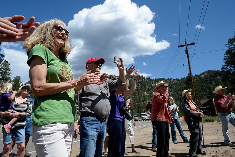 Christy Schmuhl, left, and Bert Johansen, center, applaud and take photos along with fellow Glen Haven residents Thursday, June 1, 2017, during a groundbreaking ceremony for the new Glen Haven Town Hall and Community Building. The new town hall will replace the former building that was washed away by the 2013 flood. (Photo by Jenny Sparks/Loveland Reporter-Herald)