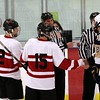 Captains Mike Felicioli, Tim Watson and Jesse Kinney at the start of a holiday tournament game.