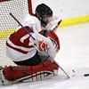 Glen Rock senior goalie Harris Nebbia stopping a shot from a Tenafly opponent.
