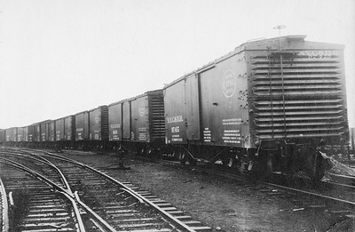2011.008.0213.11--glenn guerra collection 4.5x6.5 print--NYC&HR (NYC)--line up of new wooden boxcars Pressed Steel Car Co builders photo--location unknown--no date