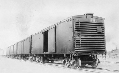 2011.008.0213.13--glenn guerra collection 4.5x6.5 print--SSW--line up of new wooden boxcars Pressed Steel Car Co builders photo--location unknown--no date