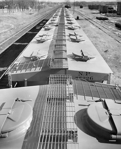 2009.002.021--glenn guerra collection 8x10 print [Russell Schweizer]--NP--company PR photo roof view of new covered hopper 75225--location unknown--1957 0000