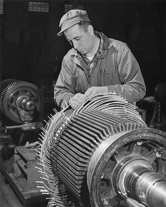 2009.002.019--glenn guerra collection 8x10 print [Lee Merrill]--NP--company PR photo of traction motor armature being rewound at shops--South Tacoma WA--c1954 0000