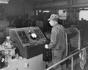 2009.002.018--glenn guerra collection 8x10 print [Lee Merrill]--NP--company PR photo of machinist MP Ginther balancing traction motor and amature with dynetric balancing machine--South Tacoma WA--1954 0000
