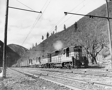 2009.002.003--glenn guerra collection 8x10 print--CMStP&P--company PR photo of EMD diesel locomotive 331 on freight train action--near Avery ID--no date