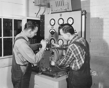 2009.002.020--glenn guerra collection 8x10 print [Lee Merrill]--NP--company PR photo of employees testing diesel locomotive governor at shops--South Tacoma WA--c1954 0000