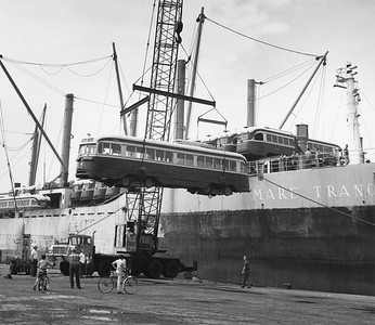 2009.002.001--glenn guerra collection 8x10 print [Eric Trussler]--TTC--company PR photo of retired PCC cars being loaded on boat to ship to Egypt--Toronto ON--1968 0700
