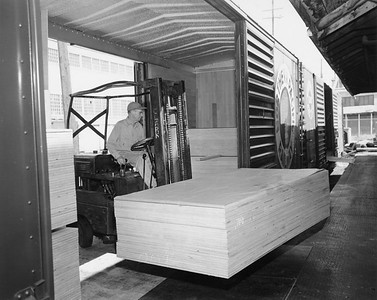 2009.002.027--glenn guerra collection 8x10 print--NP--company PR photo of 40 foot plug door boxcar in use built by NP at Brainerd MN shops--location unknown--1958 0000