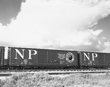 2009.002.024--glenn guerra collection 8x10 print--NP--company PR photo of new steel boxcar 7859 buiilt at NP shops Brainerd MN--location unknown--1959 0000