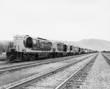 2009.002.008--glenn guerra collection 8x10 print--NP--company PR photo of new EMD diesel locomotive 225 on extra freight train--west of Missoula MT--1955 0000