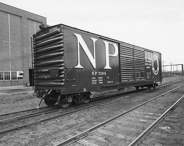 2009.002.023--glenn guerra collection 8x10 print--NP--company PR photo of new steel boxcar 7104 buiilt at NP shops Brainerd MN--location unknown--1957 0000