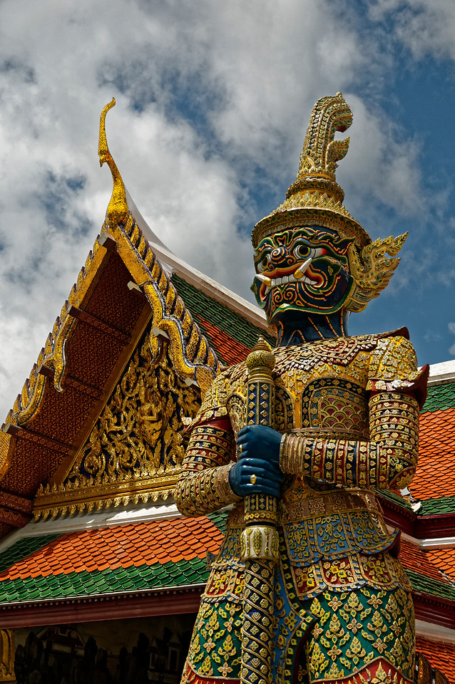 A giant <i>yaksha,</i> one of a pair of guardian demons, keeps watch over an entry pavilion inside the temple.