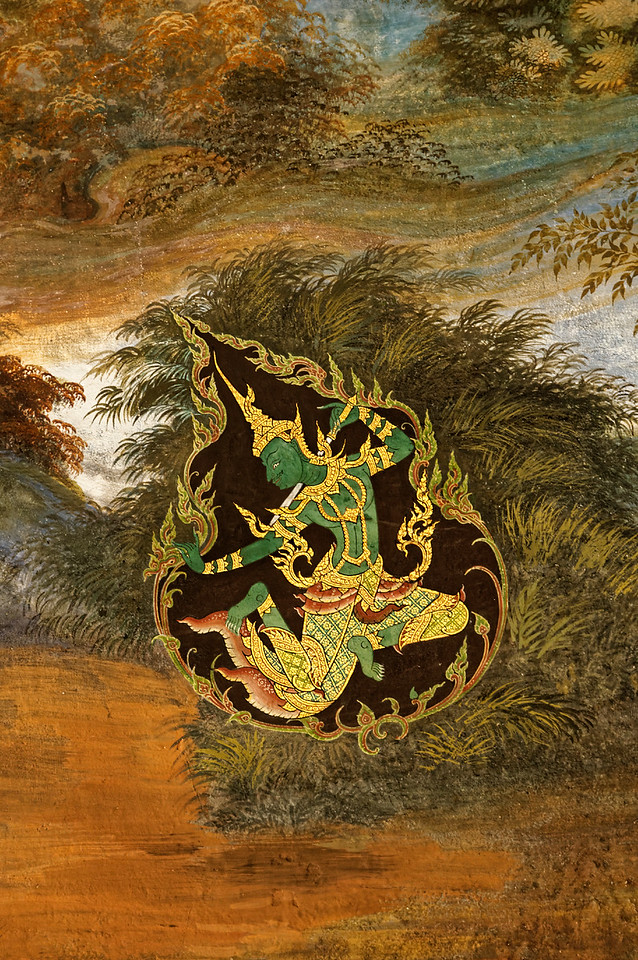 This wall painting depicting the green figure of Rama shows him enclosed within a characteristically Thai design motif called a <i>kanok,</i> a triangular swirl whose vegetal frame creates a flamelike effect. Closer inspection reveals multiple smaller <i>kanok</i> forming sections of the frame itself as well as others at the ends of the beltlike sash at Rama's waist.