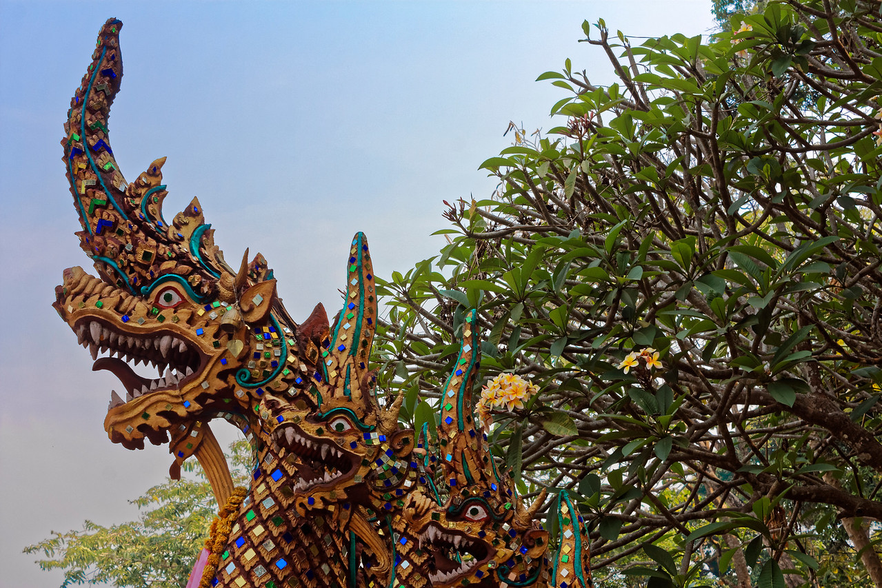 At the foot of the stairway that leads to the temple grounds, Doi Suthep's <i>naga,</i> snakelike creatures of Hindu origin, are an updated version of the traditional temple guardians that, as emblems of the rainbow, also symbolize a link between the earthly and heavenly realms.