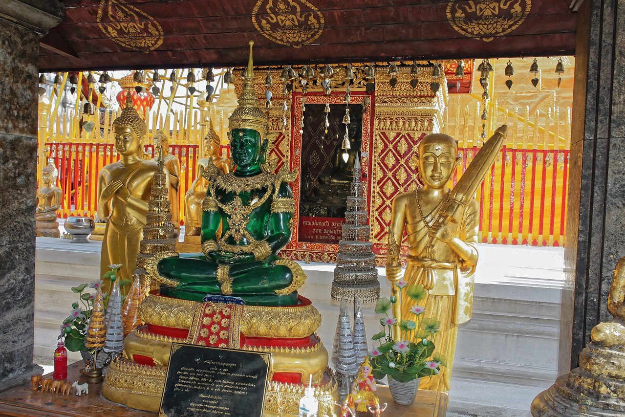 The seated Buddha is a replica of the famed Emerald Buddha, which is housed at Bangkok's Wat Phra Kaeo (Temple of the Emerald Buddha) on the grounds of the Grand Palace.