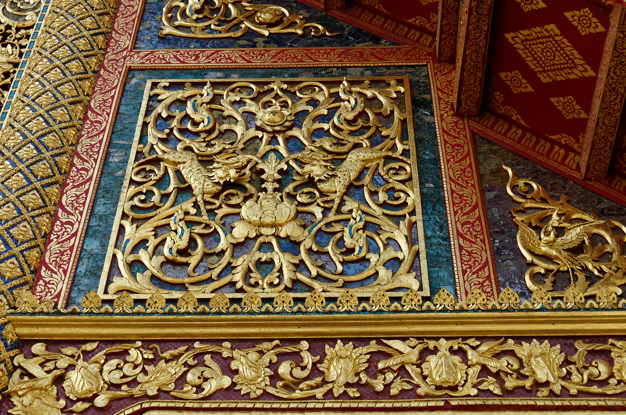 A carved and gilded wooden detail adorning the larger assembly hall