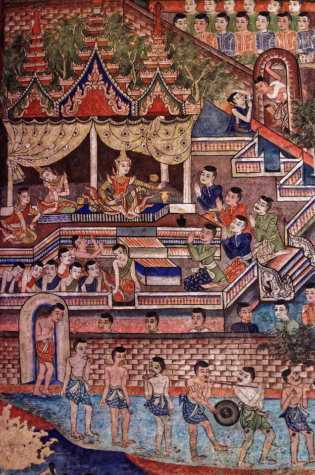 The men in the foreground seen here wear the <i>somphot,</i> a length of cloth wrapped between the legs and tucked in at the waist in back. Some have tattoos on their legs. Those kneeling before the prince show their respect by raising their hands in the traditional Thai <i>wai.</i>
