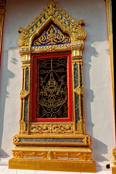 Window grillwork in the form of a meditating bodhisattva