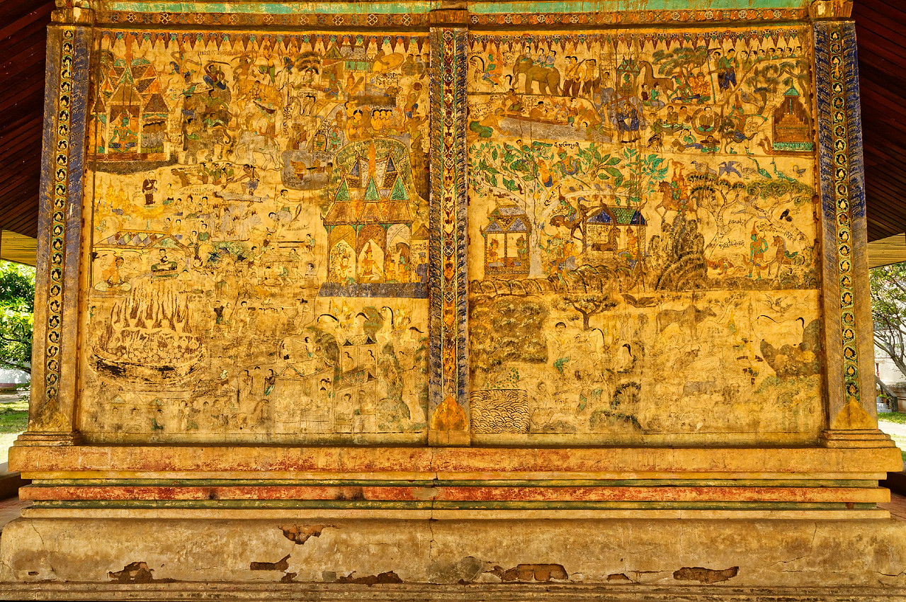The west wall of the <i>sim</i> depicts climactic scenes from the <i>Ramakien,</i> including a triumphant return from battle of Phra Lam and Phra Lak and the consignment to hell of their evil enemies.