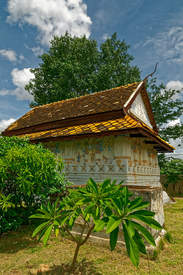 The gabled upper roof over a hipped lower tier is a typical Isaan style.