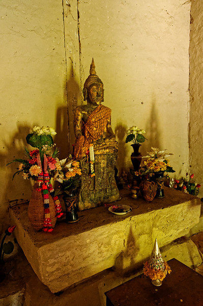 The extremely modest altar inside the <i>sim</i> holds an unusual sandstone Buddha image.