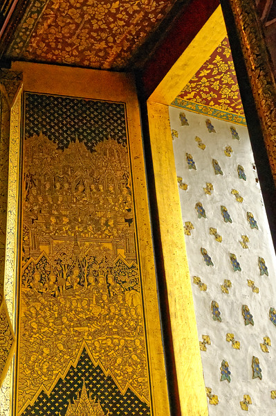 Decorative details around a window opening in the ordination hall, including a gilded and lacquered panel