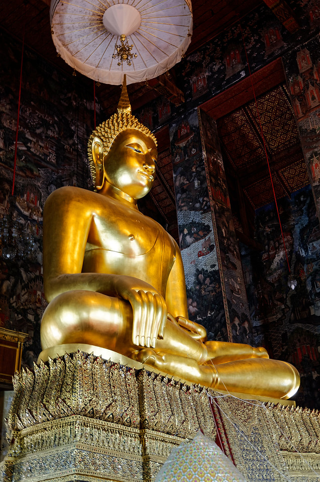 The Sri Sakyamuni Buddha, a sublime 14th-century gilded bronze sculpture, was brought to Bangkok from Sukhothai's Wat Mahathat by Rama I. Part of his purpose in ordering the founding of the temple was to accommodate this revered image, which measures over 26 feet in height.