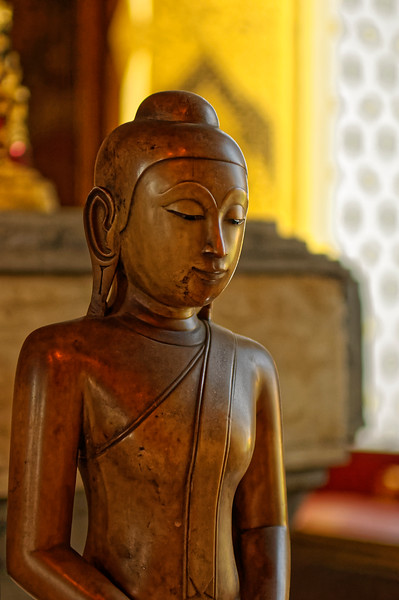 Detail of a small Buddha image in the ordination hall