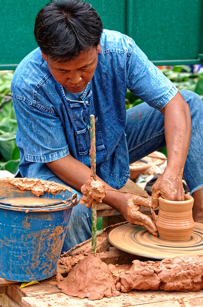 The potter, who turned out one vase after another with much skill and seemingly little effort