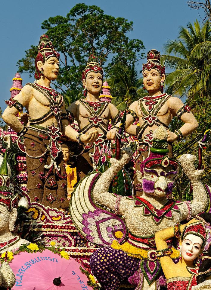 This float, featuring three kings, recreates a statue that stands near the center of Chiang Mai's old inner city, commemorating a historic event.